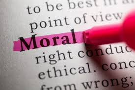 The word Moral being highlighted in a dictionary