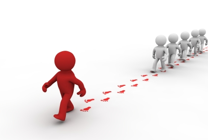 Image of a figure walking ahead and leading a group behind