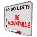 Words 'Be Accountable' on a to-do list dry erase board