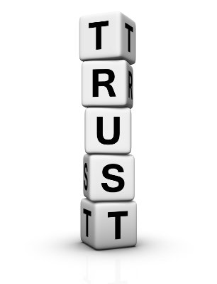 White lettered blocks stacked vertically to spell Trust