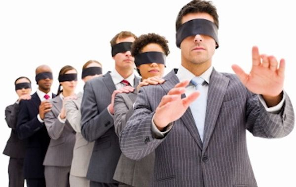 Image of a row of blindfolded business people standing with their hands on the shoulders of the person in front