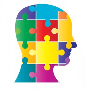 Silhouette image of a head that is made up of coloured puzzle pieces