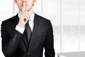 businessman silent quiet gesture with finger