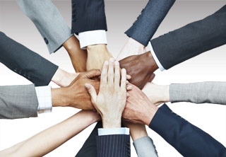 Image of many hands together in a circle