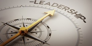 Image of a compass pointing toward the word Leadership